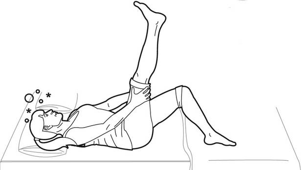 While lying on your back, straighten one leg up in the air. Hold the back of your thigh with your hands and feel a stretch in your hamstring muscles, in the back of your upper thigh. (Trish McAlaster/The Globe and Mail)