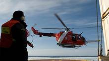 A 2008 file photo of the helicopter on the deck of the Amundsen during a research trip in the arctic. (Olivier Dessibourg)