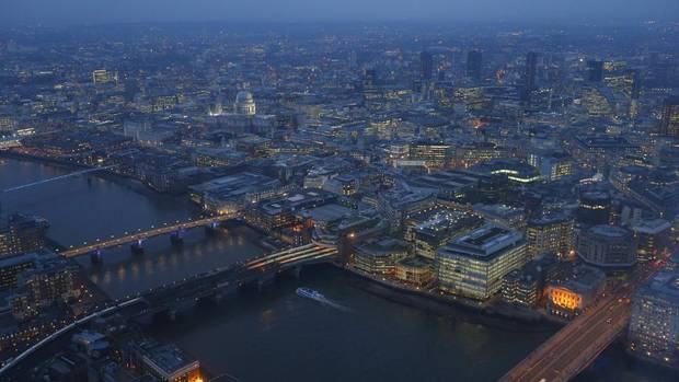 St Paul's cathedral and the financial district are seen at dusk in an aerial photograph from The View gallery at the Shard, western Europe's tallest building, in London Jan. 8, 2013. (ANDREW WINNING/REUTERS)