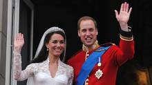 Britain's Prince William and his wife Kate, Duchess of Cambridge, wave to the crowd from the balcony of Buckingham Palace in London on April 29, 2011, (JOHN STILLWELL/AFP/Getty Images)