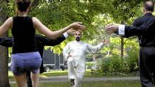 Instructor Ali Siadatan leads a class in Tai Chi in the park near Wu Xing Martial Arts. (ella Rollins for The Globe and Mail.)