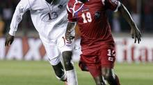 Panama's Jean Carlos Cedeno, right, and Canada's Atiba Hutchinson fight for the ball during a 2014 World Cup qualifying soccer match in Panama City, Tuesday, Sept. 11, 2012. (Arnulfo Franco/AP)