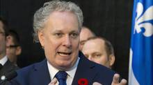 In a break with his previous position, Premier Jean Charest has given the investigation into corruption in Quebec's construction industry full powers under the Public Inquiry Commissions Act. (Jacques Boissinot/Jacques Boissinot/THE CANADIAN PRESS)