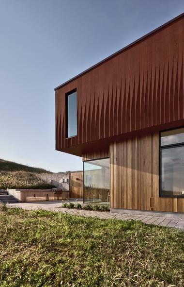Williamson Chong Architects are already using advance wood products in their designs, as here in their House in Frogs's Hollow project north of Toronto. Computer milled wood siding is a feature of the upper facade. (Bob Gundu)