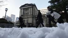 The Bank of Japan is working to combat nearly two decades of persistent deflation. (KIM KYUNG-HOON/REUTERS)