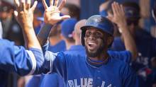 Toronto Blue Jays' Jose Reyes celebrates in the dugout after scoring in the fifth inning of MLB baseball action against the Oakland Athletics in Toronto on May 24. (Darren Calabrese/THE CANADIAN PRESS)