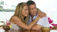 "Jennifer Aniston and Adam Sandler hug it out in a scene from ""Just Go With It"" (Tracy Bennett)"
