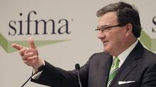Federal Finance Minister Jim Flaherty speaks at a SIFMA conference, Wednesday in New York. (Mark Lennihan/AP)
