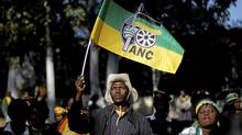 An African National Congress (ANC) supporter holds the party's flag during a march to the Goodman Gallery in Johannesburg May 29, 2012, where a portrait exposing South African President Jacob Zuma's genitals were first displayed. (SIPHIWE SIBEKO/Reuters)