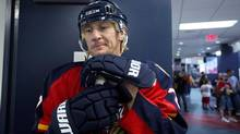 Florida Panthers' Alex Kovalev waits to have his photo taken during the NHL hockey team's photo day at training camp in Coral Springs, Fla. Sunday, Jan. 13, 2013. (The Associated Press)