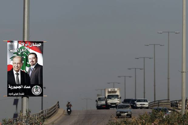 On a poster of Mr. Hariri and President Michel Aoun, the Arabic caption reads: 'Lebanon First, 10425 KM2.'