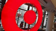 An employee at the new CityTarget store sits in a store window overlooking downtown Chicago, as they prepare for the opening, July 18, 2012. H&R's CEO says the time is right for a bid for mall owner Primaris now that Target is about to move into Canada. (JIM YOUNG/REUTERS)