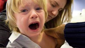 Evan Tordorf, 4, cries as he gets his H1N1 shot in Montreal on Nov. 6.