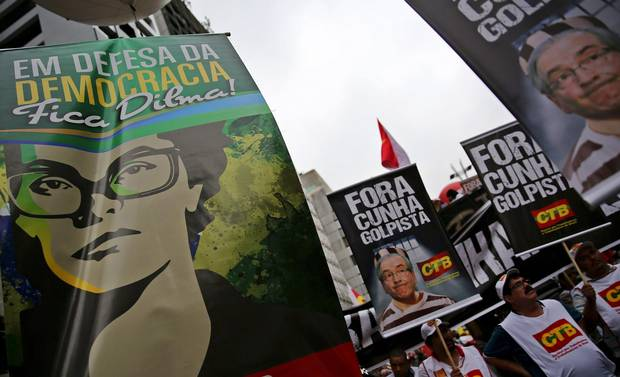 Demonstrators hold posters with the images of Brazil's President Dilma Rousseff, left, and Lower House Speaker Eduardo Cunha as they take part in a protest against the impeachment proceedings against Ms. Rousseff in Sao Paulo on Dec. 16, 2015. The posters read