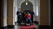 B.C. NDP Leader Adrian Dix, left, and Ken Michell, who was injured in the Babine mill explosion, head to a press conference at the B.C. Legislature in Victoria on Wednesday, March 6, 2014. (CHAD HIPOLITO/THE GLOBE AND MAIL)