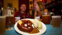 Bavarian sausage with pretzel is on the menu at the Vancouver Alpen Club during Oktoberfest. (BEN NELMS/THE GLOBE AND MAIL)