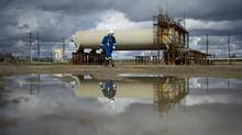 Cenovus has found that the butane used at a well at its Christina Lake operation makes the bitumen flow faster and at greater rates. (Kevin Van Paassen/The Globe and Mail)