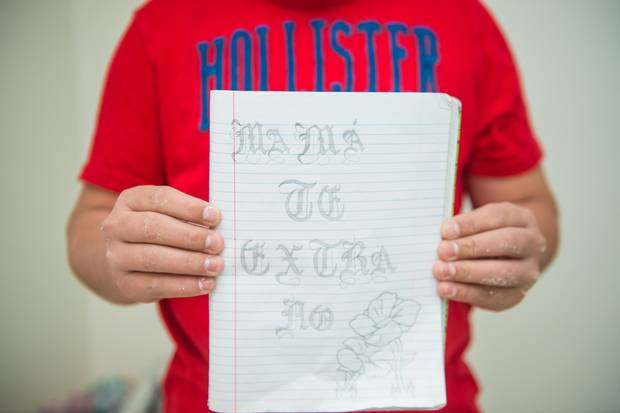 One of Fernando's drawings reads: 'Mom, I miss you.' His notebook is filled with grafitti-inspired images and cartoons written to his mother and girlfriend back in El Salvador.