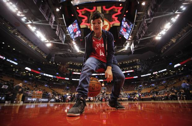 Toronto, Ontario - January 25, 2016 -- Tiago Scola -- Tiago Scola, 10 year old son of Toronto Raptors player Luis Scola, poses in front of the the Raptors dressing room before they play the L.A. Clippers at the Air Canada Centre in Toronto, Monday January 25, 2016
