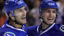 Vancouver Canucks Maxim Lapierre (L) celebrates his goal against the Calgary Flames with teammate Alex Burrows (R) during the first period of their NHL hockey game in Vancouver, British Columbia March 31, 2012. REUTERS/Ben Nelms (Ben Nelms/Reuters)