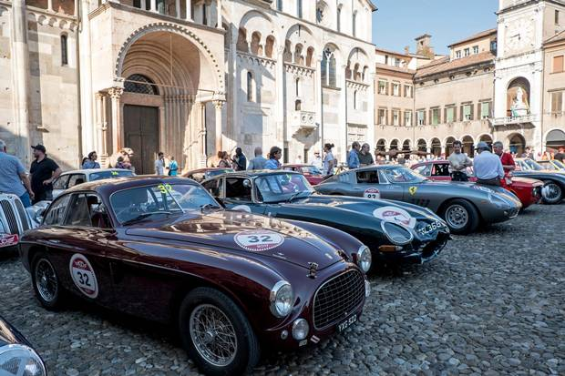 Modena's Piazza Grande serves as the finish line for the annual multi-stage Cento Ore classic car rally.