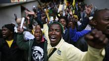 People sing and dance during the mass memorial for late former South African president Nelson Mandela at First National Bank Stadium in Johannesburg on Dec. 10, 2013. (RONEN ZVULUN/REUTERS)