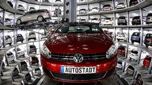 Volkswagen's Golf and the Passat are both available with a DSG automatic transmission. (REUTERS/Christian Charisius)