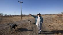 Waitress Sherri Archambeault, 58 – shown with dogs Bo and Maggie near her home in Glasgow, Mont. – supports the Keystone XL pipeline, and intends to vote for Mitt Romney in the U.S. presidential election. (Deborah Baic/The Globe and Mail)