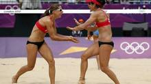 Canada's Marie-Andree Lessard (R) and Annie Martin celebrate a point against Italy's Greta Cicolari and Marta Menegatti during their women's preliminary round beach volleyball match at Horse Guards Parade during the London 2012 Olympic Games August 2, 2012. (MARCELO DEL POZO/REUTERS)