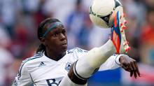 Vancouver Whitecaps' Darren Mattocks, of Jamaica, corrals the ball with his foot during the first half of an MLS game against Real Salt Lake in Vancouver, B.C., on Saturday August 11, 2012. (DARRYL DYCK/The Canadian Press)