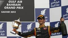 Romain Grosjean celebrates his third-place finish. (DARREN WHITESIDE/REUTERS)