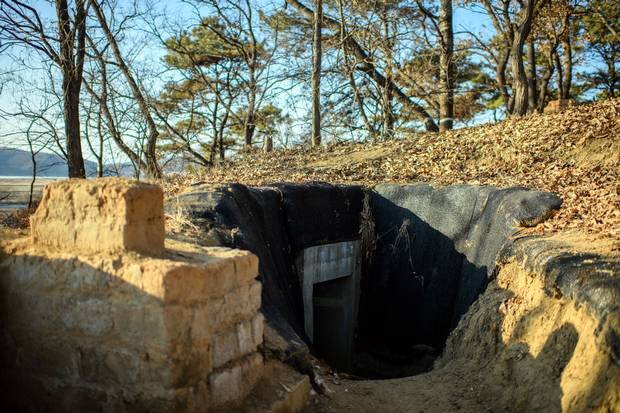 A bunker is built into an operational trench system overlooking the main highway leading toward North Korea near the DMZ.