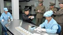 North Korean leader Kim Jong-Un visits the May 11 Factory in this undated photo released by North Korea's Korean Central News Agency (KCNA) in Pyongyang August 11, 2013. (KCNA/REUTERS)