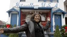 "Martha Reeves, the 65-year-old former leader of Martha and the Vandellas, whose songs ""Dancing in the Street"" and ""Heat Wave"" became Top 10 hits, stands in front of the Motown museum Hitsville U.S.A. in Detroit in this Dec. 12, 2006, file photo. (Carlos Osorio/AP)"