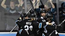 The San Jose Sharks celebrate defeating the Vancouver Canucks in overtime during Game 4 of their NHL Western Conference quarterfinal hockey playoff game in San Jose, California May 7, 2013. (Reuters)