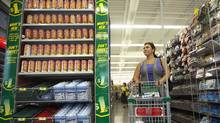 A shopper browses the aisles at the Dollarama in Vaughan, Ont. (JENNIFER ROBERTS For The Globe and Mail)