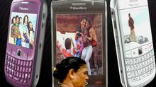 An Indian pedestrian walks past a billboard for Blackberry phones in Mumbai on August 13, 2010. (AFP/Getty Images/AFP/Getty Images)