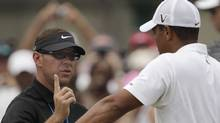 Sean Foley and Tiger Woods (Charlie Riedel)
