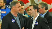 Guelph Conservative MP Marty Burke, left, chats with his director of communications Michael Sona before the Here for Canada rally April 4, 2011 in Guelph, Ontario. (Greg Layson/THE CANADIAN PRESS)