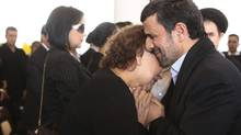 Iran's President Mahmoud Ahmadinejad comforts Elena Frias next to the flag-draped coffin of her son, Venezuela's late president Hugo Chavez, during the funeral ceremony at the military academy in Caracas. Senior Iranian clerics have criticized Ahmadinejad for consoling Chavez's mother with a hug — a physical contact considered a sin under the country's strict Islamic codes. (Marcelo.Garcia/AP)