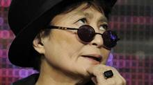 "Yoko Ono ponders a question during a panel discussion on the PBS special ""LennonNYC"" at the PBS Television Critics Association summer press tour in Beverly Hills, Calif., last week. (Chris Pizzello/AP)"