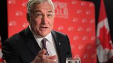 Conrad Black takes his seat at a luncheon at the Empire Club in Toronto. (Chris Young/The Canadian Press)