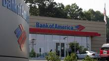 Customers walk into a branch of Bank of America in Charlotte, N.C. (CHUCK BURTON/AP)