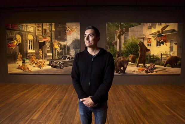 Cree artist Kent Monkman poses for a photograph at his exhibition Shame and Prejudice: A Story of Resilience in Toronto on Jan. 18, 2017.