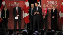 Liberal party candidate Justin Trudeau speaks while Joyce Murray, moderator Harvey Locke, Marc Garneau, David Bertschi and Martha Hall Findlay listen in at the Liberal Party of Canada leadership debate in Winnipeg on Feb. 2, 2013. It was billed as a debate, but the two plush chairs on stage made it clear Saturday's Liberal leadership event would not be your typical candidates' battle. (JOHN WOODS/THE CANADIAN PRESS)