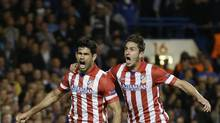 Atletico's Diego Costa, left celebrates with Koke after he scored a penalty during the Champions League semi-final second leg soccer match between Chelsea and Atletico Madrid at Stamford Bridge Stadium in London Wednesday, April 30, 2014. (Kirsty Wigglesworth/AP)