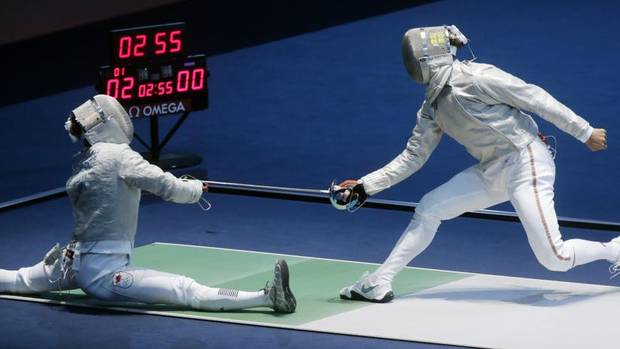 Canada's Philippe Beaudry competes against Belarus' Dmitri Lapkes during the men's individual sabre round of 32 fencing. (Dmitry Lovetsky/AP)
