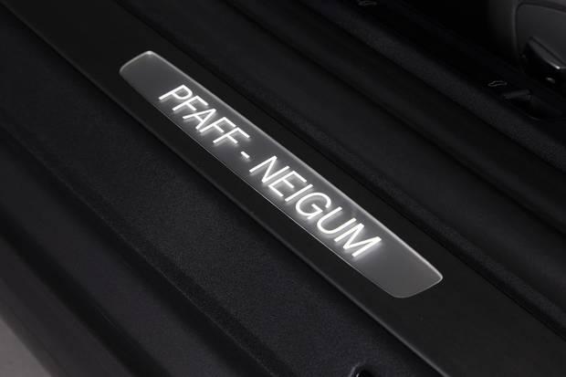 A plaque on a Sid Neigum-guided custom car from Pfaff.