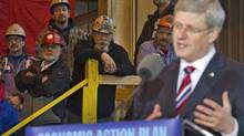 Workers listen as Prime Minister Stephen Harper details the completion of the government's deal with Seaspan shipyards to to build non-combat Coast Guard and Royal Canadian Navy vessels in North Vancouver on Jan. 12, 2012. (ANDY CLARK/Andy Clark/Reuters)