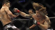 Clay Guida, right, swings at Rafael Dos Anjos during a UFC mixed martial arts match in Oakland, Calif., Saturday, Aug. 7, 2010. Guida won by submission in the third round. (Jeff Chiu/Jeff Chiu/AP)